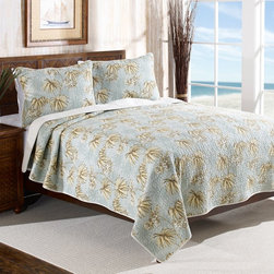 Tommy Bahama - Tommy Bahama Dulcina Reversible Cotton Quilt Set Multicolor - 200971 - Shop for Quilts from Hayneedle.com! An island getaway is as close as your master bedroom when it s touting the Tommy Bahama Dulcina Reversible Cotton Quilt Set. Crafted with 100% cotton this lofty ensemble includes a quilt and one or two coordinating shams. Each piece boasts a breezy island leaf print against a pale blue background. The prewashed fully reversible quilt has a contrasting-but-coordinating back side too for a different look. Choose from available sizes - each set is machine washable for easy care.Bedding Set Components:Twin: Quilt 1 shamFull/Queen: Quilt 2 shamsKing: Quilt 2 shamsQuilt dimensions:Twin: 88L x 68W in.Full/Queen: 90L x 90W in.King: 104L x 96W in.About Tommy Bahama HomeTommy Bahama started as an upscale men's casual sportswear line and has transformed into a signature brand expanding their product line to accommodate women's apparel golf wear footwear home furnishings and even retail and restaurant compounds. The Tommy Bahama brand represents quality products with fashion forward designs that are available at an affordable price. Their signature island-lifestyle designs suggest a modern style with an emphasis on comfort and relaxation.