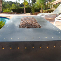 """Luger Fire Pit - 48"""" Long, 24"""" wide, 18"""" tall. 196 inlayed brass shell casings."""