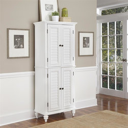 HomeStyles - Brushed White Pantry - Inspired by the fusion of British colonial and old world tropical design, the Bermuda Pantry highlights hardwood solids and engineered wood in a designer visible brushed stroke white finish. Further inspiration can be found in the shutter style designed doors and the turned feet. Bounteous storage is provided with two cabinet doors each containing two adjustable shelves. This piece is completed with antique brass hardware and is built to hold large portion items such as over-sized cereal boxes. 30 in. W x 16 in. D x 73 in. H