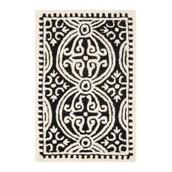 Safavieh - Zagora Hand Tufted Rug, Black / Ivory, 2' X 3' - Construction Method: Hand Tufted. Country of Origin: India. Care Instructions: Vacuum Regularly To Prevent Dust And Crumbs From Settling Into The Roots Of The Fibers. Avoid Direct And Continuous Exposure To Sunlight. Use Rug Protectors Under The Legs Of Heavy Furniture To Avoid Flattening Piles. Do Not Pull Loose Ends; Clip Them With Scissors To Remove. Turn Carpet Occasionally To Equalize Wear. Remove Spills Immediately.