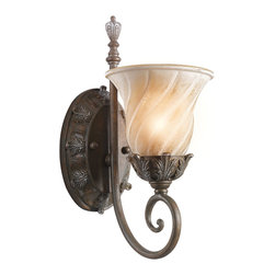 Kichler 1-Light Wall Fixture - Legacy Bronze - One Light Wall Fixture This 1 light wall sconce from the Sarabella collection has attractive European styling. Its classical influences - sensual curving, intricate leaf detailing and a beautifully aged legacy bronze finish - act as a bold backdrop to its soft, artistic shade. A shade that add unusual depth and interest as a result of its subtle ribbed detailing. Width: 6, height: 14. 5, extension: 9, height from center of wall opening: 8. Uses 1 100w max bulb. Rated for damp locations.