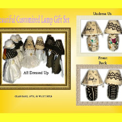 "The Wedding Gift 1 8pc set - Brides Lamp is dressed in beautiful white dress with pretty gold flowers. The shade has real hair and removable hat with veil. One side is white brocade while the other is white mud cloth. Gold tone bells and fertility pieces accessorize its edges. Undress the base to white mud cloth on one side with black print. Adorned with champagne bottle and glass, brooms, white doves, our wedding day ribbon. Turn it around you have black mud cloth with white stripes. The Groom wears a sharp White three piece suit, and carries cowrie shells and rings in the hands. The shade is white mud cloth, its edges have gold tone bells. The base is white mud cloth with black print on one side and black mud cloth with white stripes on the opposite side. The front has champagne, with burgundy butterflies in the champagne glass. The Brides maids are dressed in darling off white dresses and little matching removable bonnets. Undress each of them to gold, rust and black mud cloth. One side has champagne glass and bottle, rings and brooms. Each shade matches the base. The Groomsmen are rust, gold and black mud cloth. champagne bottle and glass accessorizes one side, including gold tone bell. Each comes with matching shade. Lamps can be displayed in numerous ways. With cloths, with or without hair and veil, without cloths, all white, all black, white top black bottom, black top white bottom. Each lamp Stands 18""h, has a glass base and uses a 60 watt bulb. The gift that will be talked about for years to come."