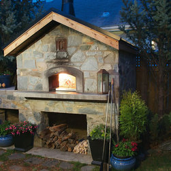 "Mugnaini Wood Fired Ovens - Mugnaini Wood Fired Ovens Residential Exterior - For 25 years, Mugnaini has been ""the oven"" for serious chefs and home cooks alike. Mugnaini wood-fired pizza ovens are handcrafted by Refrattari Valoriani in Tuscany, Italy. Using the key components from Valoriani, customers can choose from factory assembled ovens or masonry oven kits in a variety of shapes and sizes. Learn more at www.mugnaini.com"