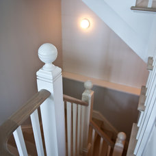Traditional Staircase by BPC ARCHITECTURE