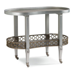 "Schnadig - Caracole Dean Martini - Entertaining is made easy when Dean Martini is on your guest list! This glamorous beverage cart will roll into any party and create a stir. Petite scaling, 40"" wide by 22"" deep it will float nicely in a corner and will not be overpowering in a crowd. We chose Dawn, a soft, metallic grey blue finish with Matte Bronze and Gold metal ring accents. The top features antique mirror, complimenting the Dawn finish. For serving, Dean Martini offers you eight round slots for your favorite beverage storage and a gracious open area for additional entertaining supplies. Dean is only seen at the best parties, we hope he shows up at your next event."