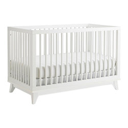 Ti Amo - Ti Amo Moderna Island Crib - Snow White - Vintage styling with modern appeal the Ti Amo Moderna Island Crib - Snow White is a great centerpiece for any nursery. The round spindles and platform style base add an urban edge to this classic crib. Parents will appreciate the versatility of being able to position this crib in the center of a room or next to a wall. Coordinates beautifully with the Ti Amo Changing Station. Dimensions 36 x 54.5 x 30. Weight 61 lbs.