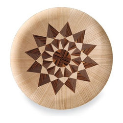 Herman Miller - Nelson Select Tray - This reissue of George Nelson's 1961 molded-top tray is a true stunner. The wooden veneers that create the starburst are made of walnut and santos palisander wood. It's a statement piece that comes with a statement price, but it is designed to last for years and years.