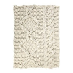 Aran rug by Christien Meindertsma - The Netherlands 2011 Acclaimed Dutch designer, Christien Meindertsma, explores folk art, using local resources and tracing materials back to where and how they are sourced. This rug is hand knit using natural un-dyed wool from Dutch sheep.