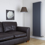 Hudson Reed - Savy Anthracite Tall Vertical Designer Radiator 63 x 18 & Valves - Eight circular vertical tubes, finished in superior anthracite powder coat,(RAL7016), make this radiator a striking design feature of any contemporary living space. The large diameter tubes deliver an amazing heat output of 1569 Watts (5349 BTUs).Stylish and effective, this modern classic connects directly into your domestic central heating system by means of the radiator valves included . Anthracite Vertical Tube Designer Radiator 63 x 18½ Features  Dimensions (H x W x D): 63 x 18½ x 3¼ (1600mm x 472mm x 80mm) Output: 1569 Watts (5349 BTUs) Maximum Projection from Wall: 5.25 (133mm) Pipe centres with valves: 22⅞ (580mm) Number of columns: 8 Circular columns Fixing Pack Included (see image above) Designed to be plumbed into your central heating system Suitable for bathroom, cloakroom, kitchen etc. Weight: 43.65 lbs (19.8kg) Please note: angled radiator valves included  Please Note: Our radiators are designed for forced circulation closed loop systems only. They are not compatible with open loop, gravity hot water or steam systems.