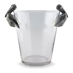 Medici Ice Bucket - A nautical conversation piece that invites a shorebird species into the formal decorative role normally reserved for more traditional heraldic beasts, the Pelican Ice Bucket has a high-end silhouette and a wonderfully weighty, tapered glass body. The surprisingly realistic feathers of the pure pewter pelicans at either side add grace and detail to the beautiful bucket.