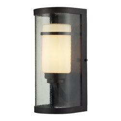 Elk Lighting - EL-14101/1 Caldwell 1-Light Outdoor Sconce in Oiled Bronze - This Indoor/Outdoor Collection has innovative styling for a clean, transitional appearance. The subtle textured clear outer glass surrounds the smaller opal white glass cylinder inside for added depth and character. The powered coated steel frame is finished in oiled bronze.