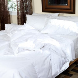 Belle Epoque Chateau Down Comforter - Light Weight - Stay cool on hot nights under the Belle Epoque Chateau Down Comforter - Light Weight. This thinner comforter is the perfect weight for summer evenings so you can enjoy the distinctive comfort of down while benefitting from its temperature-modulating properties. With a cover made from high thread count 100% cotton this comforter is stuffed with European white duck down with a luxurious fill power of over 650. The baffled box-stitch construction uses an inner wall of fabric to let the fill loft to achieve its maximum capacity while the quilted pattern keeps the stuffing evenly distributed throughout the comforter. This comforter is conveniently machine-washable and is backed by a three-year limited warranty. Comforter Dimensions: Twin: 66 x 88 inches Full/Queen: 92 x 95 inches King: 110 x 95 inches About CGG Home FashionsWhether you are shopping at Bloomingdale's or relaxing at a premier resort you are sure to find and appreciate CGG Home Fashions products. For over 20 years the company has been offering a broad selection of luxury linens high thread count sheets duvet covers pillows down and synthetic comforters drapes and table linens. CGG's acclaimed Belle Epoque collection is the epitome of elegance with styles ranging from traditional to contemporary. With offices and a warehouse in Yonkers New York and a showroom on New York's Fifth Avenue CGG is at the epicenter of textile design and innovation.