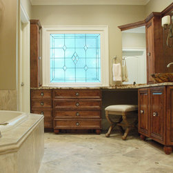 Morgan Farm Dr - Specialty Tile Products recently provided the tile for this gorgeous master bath suite designed by Janis and Associates.  The tile is a mix of porcelain and accent dots, which are precisely cut to fit into the floor.  The floor is Nu Travertine, while the countertops are marble.