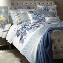 Designers Guild - Designers Guild King White Flat Sheet with Embroidered Blue Trim - Larger-than-life peonies on white sateen plus quilted silk equals sublime. From Designers Guild®. Floral linens and sheeting are 300-thread-count cotton. Duvet cover reverse and boudoir sham are striped. Hand-quilted silk quilts and shams reve...