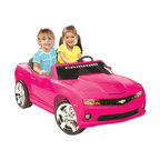 Kid Motorz - Kid Motorz Chevrolet Camaro Battery Powered Riding Toy - Pink - 0812 - Shop for Tricycles and Riding Toys from Hayneedle.com! Who doesn't like convertibles? The Kidz Motorz Chevrolet Camaro Two Seater Battery Powered Riding Toy - Pink is one hot convertible every little girl would be thrilled to own. This officially licensed version of the Chevrolet Camaro operates on a 12-volt battery that propels two passengers at speeds up to 5 MPH when the little driver pushes on the gas pedal. To bring the car to a smooth stop all she has to do is remove her foot from the gas pedal. We know it's important to keep drivers especially young drivers undistracted but this car is equipped with a few extra features. Electronic sound buttons play different authentic noises and this vehicle has an MP3 outlet so she can plug in any MP3 or iPod. There's also a real working FM radio. Additional features: Crafted of plastic and steel Chrome grille and hubcaps Pretend seatbelt About National ProductsA leading toy manufacturer and exporter in Hong Kong National Products is part of a group of four firms called the Playmind Ltd. Group. As recognized by peers the company is both a reputable and reliable working partner as well as supplier in the toy and ride-on industry. Most importantly not just children have fun with National Products ride-on products; parents also appreciate the detailed life-like quality and safety of the innovative designs. National meets or exceeds all safety/quality control government guidelines.