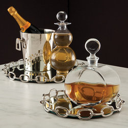 Linked Mirror Tray - Small - Adding handsome whimsy and substantial personality to a tablescape or giving a more tailored photo-ready look to your drink decanters, the Linked Mirrored Tray is a handy addition to any room.  This transitional round tray with its reflective floor has walls of bright silver cable chain ringing its glassy center, both keeping the contents from sliding off and contributing a rhythmic, stark design element to a set of barware or a vanity vignette.
