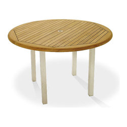 Westminster Teak Furniture - Vogue Teak and Stainless Steel 5ft Round Table - This round teak outdoor table makes seating arrangements elegant yet easy and fun; no one needs to be at the head of the table! The 5 ft tabletop is lined with Sikaflex between slats giving it the  practicality and grandeur of nautical style.  Whether its dinner under the stars, a quiet breakfast overlooking the garden or cocktails by candlelight, this stainless steel and teak outdoor table will transform your space into one of high-style luxury outdoor dining.
