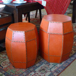 Octagonal Leather Box/Side Table - These exotic tables add rich leather, interesting geometry (rounded off octagon, anyone?) and the texture of upholstery nails. It's a perfect way to add a worldly layer to your home.