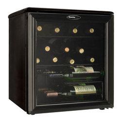 Danby - 17 Bottle Wine Cooler - 17 bottle (1.8 cu. ft.) capacity, Shatter resistant tempered glass door, Auto-Cycle Defrost, Scratch resistant worktop, 2 full width wire shelves, 1 staggered shelf, Reversible door hinge, Unit dimensions (17 8/16 x 19 11/16 x 20 2/16)