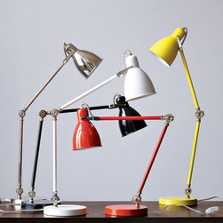Industrial Task Table Lamp - You know the guy whose entire home is lit by the ugly ceiling lights that came with the place, and maybe some ugly torchiere fire hazard lamp from the mid-nineties? That guy needs this classic task lamp which is perfect for a desk, workshop, side table or nightstand.