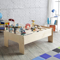 "Sodura - Birch Wood Modern Kids Train Table - This modern train table is made exclusively for Modern Tots, and is made right here in the USA, so we know what to expect from the quality.  Most other activity tables have legs that are thin and warp easily, but our train table has a beefy 3/4"" thick leg that won't warp or crack when moving the table or from children climbing on it.The table is for kids, but it is made of all birch wood and will support 300 pounds just like adult furniture.  It is great for all kinds of kids activities like trains, puzzles, and Lego's.   It's large table top is the perfect size for Thomas and Friends train sets and Brio train sets.  Assembly is a breeze with just a few bolts on each side of the play table. Available in Natural Birch color with an industrial grade finish, that happens to be low VOC and non-toxic. Dimensions: 48""L x 36""W x 17""H"