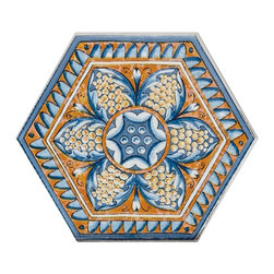 """Basilica Flower - Basilica Flower 7""""x8""""is a porcelain tile with the geometric shape of a hexagon. This vibrant tile has the combinations of blue, white and orange. Blue and orange border the tile creating a wave affect that makes a nice movement in the tile. In the center of the tile is a beautiful blue, white and a lighter shade of orange flower. The Flower will pollinate a floor with beauty and creativity. The hexagon shape gives you the power to create different designs and patterns. The tranquil Flower design gives a villa feel."""