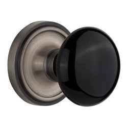 Nostalgic - Nostalgic Passage-Classic Rose-Black Porcelain Knob-Antique Pewter (NW-710001) - The simple elegance of the Classic Rosette in antique pewter offers beauty and durability that will compliment a variety of architectural styles. Add our timeless, kiln-fired Black Porcelain Knob to create a sophisticated, yet classic look. All Nostalgic Warehouse knobs are mounted on a solid (not plated) forged brass base for durability and beauty.