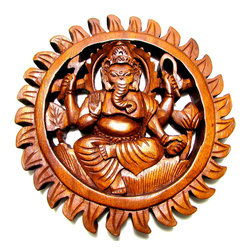 BaliBoutiqueOnLine - Ganesh Carving - Ganesh is the remover of obstacles, the wealth of wisdom known for his willingness to assist in the daily needs of his followers. This hand carved wooden wall hanging is made of suar wood with a dark brown finish and depicts Ganesh in intricately detailed fashion, making it a great addition to spiritual practice and spaces (includes hook for hanging).