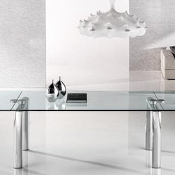 Reflex - Policleto Glass Dining Table - The Policleto table by Reflex features an ingenious extension mechanism of precise simplicity. Employing only two couplings the mechanism simultaneously joins the table legs, tempered glass top, and extension leaves while reducing visual details to a minimum and imparting a weightless balance to the design. Little effort is required to rotate the leaves outward and up into place at the table ends.