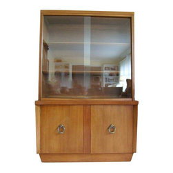 Pre-owned Vintage China Cabinet by American of Martinsville - A beautiful, rare, Mid-Century bow front hutch. The hutch is in very good, very clean condition with its original finish. It has small proportions and would be ideal for apartment living or a small house. The top portion has a sliding glass door and two wooden shelves with grooves in the back to display china. The bottom portion opens to a storage area. It does not appear to have the original hardware. There is a piece of veneer missing on the side and a few scrapes, which you can see in the photos but nothing major.