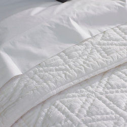 Swiss Dot Quilt - Our fluffy cotton quilt pairs the delicate texture of Swiss dot with sheer, smooth voile, lacing the two together with chunky, hand-worked stitches. The result is a bed cover that's cloud-soft and lofty with down-to-earth contemporary style.