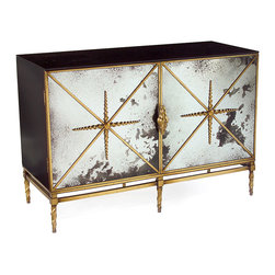 "Rio Two Door Cabinet - A stunning amalgam of the traditional and the modern, the Rio Two Door Cabinet brings a shimmery beauty to your transitional decor. Door panels of foxed mirror impart old-world glamour; black lacquered ends suggest sleek modernity. Adding to the timeless allure of the piece:  a steel base frame finished in old gold that offers a glimmer of the past that befits the present. The left side of the cabinet has an ""X"" frame; the right side has a shelf."