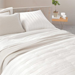 "Pine Cone Hill - Pine Cone Hill Mod Pintuck White Duvet Cover - The subtly sensational Neutral Territory collection by Pine Cone Hill offers lush layering options for a well-dressed bed. Clean and sophisticated, the white Mod Pintuck pillow sham gleam with understated texture in it's rows of clustered folds. Shown with the Mod Pintuck sham and Petite Ruffle white sheets and sham (each available separately). Duvet cover is made from 100% cotton. Machine wash, tumble dry low. Available in twin, full/queen and king sizes. Twin measures 68"" x 86"". Full/Queen measures 88"" x 88"". King measures 102"" x 92""."