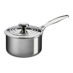 Le Creuset - Le Creuset Stainless Steel Saucepan with Lid - SSP1100-16 - Shop for Sauce and Saute Pans from Hayneedle.com! Create delicious sauces and sides with the Le Creuset Stainless Steel Saucepan with Lid. Crafted from durable tri-ply stainless steel this saucepan has a full aluminum core protected by the rolled sealed and polished rim which heats quickly and evenly as well as a magnetic external layer which is induction-compatible and infused with titanium to resist discoloration. Made up of surgical-grade stainless steel the interior provides a safe and stable cooking surface while the proprietary steel blend of the pan resists pitting and scorching and maintains its luster over time. Featuring an ergonomic handle for easy maneuvering this pan also has a precision-pour rim which allows for clean easy pouring straight from the pan. The included lid has a relief vent to release steam and prevent boil-over while the laser etched interior capacity makes measuring easy. Oven safe up to 500 degrees Fahrenheit this pan is safe for gas electric ceramic halogen and induction stovetops. Additional Features Exterior is infused with titanium to resist discoloration Inside layer made of surgical-grade stainless steel Provides a safe and stable cooking surface Features a precision-pour rim Allows for clean convenient pouring from pan Ergonomic handle for easy maneuvering Proprietary steel blend resists pitting and scorching Maintains its luster over time Self-sealing lid locks in moisture Lid has a relief vent to release steam Helps to prevent boil-over Laser-etched interior for easy measuring Oven safe to 500 degrees Fahrenheit Safe for gas electric and ceramic stovetops Also safe on halogen and induction stovetops Dishwasher safe Limited lifetime warranty About Le Creuset of America Inc.From its cast iron cookware to its teakettles and mugs Le Creuset is a global standard of inimitable color and quality. Founded in 1925 in the northern French town of Fresnoy-Le-Grand Le