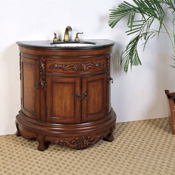 Legion Furniture 36 Inch Round Acanthus Black Granite Top Vanity - Legion Furniture 36 Inch Round Acanthus Black Granite Top Vanity is elegantly presented with a white ceramic sink and black granite surface atop a medium brown four door cabinet base.
