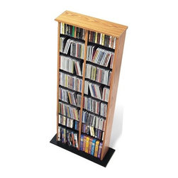 Prepac - Double Media Multimedia Storage Rack - Prepac''s multimedia collection represents the most complete assortment of high capacity multimedia storage in the world. Every product has been designed and engineered to accommodate large capacities of CDs, DVDs, videos and cassettes. Attractive finishes, curved edges, quick-assembly fasteners and unique protective packaging make Prepac the undisputed champion in this new and exciting high growth category. An attractive multi-media storage tower with central divider, the Double Media Tower is designed to accommodate any combination of media in a modest collection. Fully adjustable shelves can be set to any position to accommodate your collection and ensure full flexibility for future changes. With ample shelf space, two finishes to choose from, and attractive, curved edges, the Double Media Tower is perfect for organizing any music or video collection. Features: -Adjustable shelves.-Attractive, curved edges.-Ample shelf space.-Distressed: No.-Collection: Floor Media Storage.-Country of Manufacture: Canada.Specifications: -Holds 320 CDs, 130 DVDs and 80 videos or 70 Disney videos.Dimensions: -Overall Product Weight: 30 lbs..Warranty: -5 year manufacturer''s limited warranty. About the Manufacturer: About Prepac: Founded in 1979, Prepac Manufacturing is a state-of-the-art manufacturer of home furnishings and storage products with its main manufacturing factory located in the heart of the forest-rich province of British Columbia, Canada. Prepac is now one of the largest producers of ready to assemble furniture in Canada, with full-service representation throughout North America. To ensure our customers receive outstanding design and quality at competitive prices, Prepac''s design, engineering, production, testing and packaging are all done in-house.