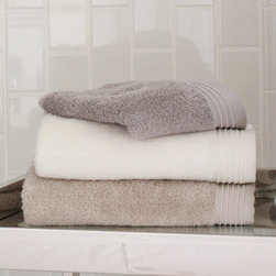 "Peacock Alley - Peacock Alley Bamboo Bath Towel - Peacock Alley's bamboo bath collection  indulges with sumptuously soft texture. With a textured and striped border, these plush, absorbent accessories exude effortlessly modern simplicity. Available in several sizes; Available in driftwood, flint, ivory, linen, wheat and white; 100% cotton; Machine washable; Bath towel: 30""w x 56""H; Hand towel: 20""w x 30""H; Wash cloth: 13""W x 13""H; Sheet: 38""W x 68""H"