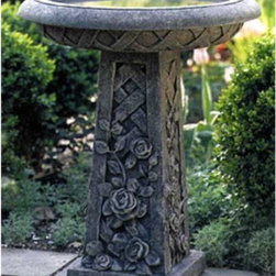 Campania International - Campania International Rose Bird Bath - B-072-NA - Shop for Garden Bird Baths from Hayneedle.com! The Rose Bird Bath features a detailed lattice design with an elegant climbing rose pattern. A poured concrete product cast stone is much more dense than clay and is less likely to absorb as much water as terra-cotta.All of our cast stone items are available in nine patinas in addition to natural stone. Our patina finishes are hand applied; therefore no two pieces are identical. Any cast stone item with a patina finish will theyther naturally in an outdoor environment assuring that your piece will age with grace. The Rose Bird Bath arrives in two easy-to-assemble pieces.The item above is shown in Alpine Stone.About Campania InternationalEstablished in 1984 Campania International's reputation has been built on quality original products and service. Originally selling terra cotta planters Campania soon began to research and develop the design and manufacture of cast stone garden planters and ornaments. Campania is also an importer and wholesaler of garden products including polyethylene terra cotta glazed pottery cast iron and fiberglass planters as well as classic garden structures fountains and cast resin statuary.Campania Cast Stone: The ProcessThe creation of Campania's cast stone pieces begins and ends by hand. From the creation of an original design making of a mold pouring the cast stone application of the patina to the final packing of an order the process is both technical and artistic. As many as 30 pairs of hands are involved in the creation of each Campania piece in a labor intensive 15 step process.The process begins either with the creation of an original copyrighted design by Campania's artisans or an antique original. Antique originals will often require some restoration work which is also done in-house by expert craftsmen. Campania's mold making department will then begin a multi-step process to create a production mold which will properly replicate the detail and texture of the original piece. Depending on its size and complexity a mold can take as long as three months to complete. Campania creates in excess of 700 molds per year.After a mold is completed it is moved to the production area where a team individually hand pours the liquid cast stone mixture into the mold and employs special techniques to remove air bubbles. Campania carefully monitors the PSI of every piece. PSI (pounds per square inch) measures the strength of every piece to ensure durability. The PSI of Campania pieces is currently engineered at approximately 7500 for optimum strength. Each piece is air-dried and then de-molded by hand. After an internal quality check pieces are sent to a finishing department where seams are ground and any air holes caused by the pouring process are filled and smoothed. Pieces are then placed on a pallet for stocking in the warehouse.All Campania pieces are produced and stocked in natural cast stone. When a customer's order is placed pieces are pulled and unless a piece is requested in natural cast stone it is finished in a unique patinas. All patinas are applied by hand in a multi-step process; some patinas require three separate color applications. A finisher's skill in applying the patina and wiping away any excess to highlight detail requires not only technical skill but also true artistic sensibility. Every Campania piece becomes a unique and original work of garden art as a result.After the patina is dry the piece is then quality inspected. All pieces of a customer's order are batched and checked for completeness. A two-person packing team will then pack the order by hand into gaylord boxes on pallets. The packing material used is excelsior a natural wood product that has no chemical additives and may be recycled as display material repacking customer orders mulch or even bedding for animals. This exhaustive process ensures that Campania will remain a popular and beloved choice when it comes to garden decor.Please note this product does not ship to Pennsylvania.