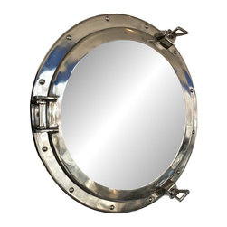 Handcrafted Nautical Decor - Deluxe Class Chrome Porthole Mirror 20'' - This Deluxe Class Chrome  Porthole Mirror 20''   adds sophistication, style, and charm for those  looking to enhance       rooms with a nautical theme. This boat porthole  has a sturdy,  heavy and      authentic appearance, yet it is made of  chrome and glass which can easily be hung to grace any nautical theme wall. This   porthole mirror     makes a fabulous style statement in any room with   its classic  round     frame, twelve metal-like rivets and two dog ears.   This marine porthole mirror     has an 14'diameter and 4.25'deep when dog-ears are attached, 2' deep without dog ears attached.----Dimensions: 20'Long x 2'Wide x 20'High----    Functional porthole mirror that will reflect the light in any space--    --    Handcrafted from solid chrome  by our master artisans--    Decorative yet fully functional port hole mirror decoration--    Realistic nautical decor - modeled after an antique 19th-century ship's porthole--    --    Great porthole wall decor and an instant conversation piece--