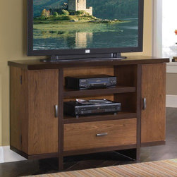 "Home Styles - Homestead 52"" Geo TV Stand - Features: -Art Deco inspired style unites with modern function that provides copious storage for entertainment demands.-Frame and top edges feature contrasting dark walnut veneer trim.-Features two full depth side compartments - doors swing out to reveal generous storage space for CD's and DVD's.-Cleverly designed side cabinets that provide storage not only within the cabinet but also on the interior of the doors.-Center features open storage space with adjustable shelf and large easy glide storage drawer.-Drawer front drops down for easy access to game equipment.-Cable accessible.-Hardwoods and veneer construction.-Antique brass finish hardware.-Recommended TV Type: Up to a 42"" flat panel TV.-Finish: Nutmeg / Dark walnut .-Powder Coated Finish: No.-Gloss Finish: No.-Material: Poplar solids and oak veneers.-Distressed: No.-Exterior Shelves: Yes -Number of Exterior Shelves: 2.-Adjustable Exterior Shelves: Yes..-Drawers: Yes -Number of Drawers: 1.-Drawer Interior Finish: Same as exterior.-Drawer Glide Material: Metal.-Drawer Glide Extension: 0.75.-Safety Stop: Yes.-Ball Bearing Glides: No.-Drawer Dividers: No.-Drawer Handle Design: Linear pulls..-Cabinets: Yes -Number of Cabinets: 2.-Number of Doors: 2.-Door Attachment Detail: Hinges.-Magnetic Door Catches: Yes.-Cabinet Handle Design: Linear pulls.-Number of Interior Shelves: 8.-Adjustable Interior Shelves: Yes..-Scratch Resistant (Scratch Resistant) : No.-Hardware Finish: Mahogany solid hardware.-Casters: No.-Accommodates Fireplace: No.-Fireplace Included: No.-Lighted: No.-Media Player Storage: Yes.-Media Storage: Yes.-Cable Management: Cable management opening.-Remote Control Included: No.-Batteries Required: No.-Swatch Available: No.-Commercial Use: No.-Collection: Homestead.-Eco-Friendly: No.-Recycled Content: No.-Lift Mechanism: No.-Expandable: No.-TV Swivel Base: No.-Integrated Flat Screen Mount: No.-Non-Toxic: Yes.-Product Care: Clean with damp cloth.Specifications: -ISTA 3A Certified: Yes.-CARB Certified: Yes.-FSC Certified: Yes.Dimensions: -Overall Height - Top to Bottom: 32"".-Overall Width - Side to Side: 52"".-Overall Depth - Front to Back: 18"".-Drawer: -Drawer Interior Height - Top to Bottom: 5.75"".-Drawer Interior Width - Side to Side: 29.5"".-Drawer Interior Depth - Front to Back: 14.5""..-Shelving: -Shelf Height - Top to Bottom: 16.25"".-Shelf Width - Side to Side: 31.25"".-Shelf Depth - Front to Back: 16.25""..-Cabinet: -Cabinet Interior Height - Top to Bottom: 23.5"".-Cabinet Interior Width - Side to Side: 9.25"".-Cabinet Depth - Front to Back: 6""..-Overall Product Weight: 165 lbs.Assembly: -Assembly Required: Yes.-Tools Needed: Phillips screwdriver.-Additional Parts Required: No.Warranty: -Product Warranty: Vendor replaces parts for 30 days."