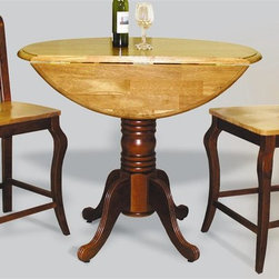Sunset Trading - 3-Pc Round Dining Set - Eco-friendly. Includes round table and two chairs. Solid handcrafted hardwood. Sturdy quality craftsmanship. Chair with cabernet triple-X back styling. Table with two 10 in. drop leafs. Accommodates tow to four people. Warranty: One year. Made from Malaysian oak. Light oak and nutmeg finish. Chair made in Thailand and table made in Malaysia. Assembly required. Chair: 18.5 in. W x 21 in. D x 40 in. H (24.74 lbs.). Table: 42 in. Dia. x 36 in. H (54.42 lbs.)Add classic charm to your home without compromising space or style. Perfect for a small dining area or cozy nook, this Sunset Trading - Sunset Selections Collection double Drop Leaf Table serves your day-to-day needs yet transforms into the extra needed dining space when guests drop by. It may be small in size but it's large in versatility to meet your dining needs. Complete your dining decor with this traditional yet stylish cafe chair from the Sunset Trading - Sunset Selections Collection. Its casual charm is versatile enough to complement traditional, country or modern decor. Perfect for everyday casual dining or entertaining guests at your cafe table or kitchen snack bar. Offering traditional classic beauty and style, yet always dependably functional, your family and friends will enjoy the seating comfort of this inviting cafe chair for years to come.