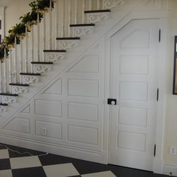 Interior doors - Under stair door incorporated with wall panels.