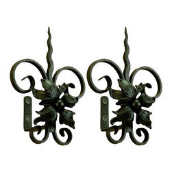 The Merchant Source - Metal Tieback in Black - Floral with Spear - Set of 2 (Gunmetal) - Finish: Gunmetal. Graphic, bold proportions and expert craftsmanship are given equal attention with this pair of curtain tiebacks. The forged metal tiebacks feature a tapered spear top, while a realistic floral motif highlights each center. Just pick a finish color for that customized appearance. Set of 2. Black finish. Made of Forged Metal. 6 in. L x 9 in. W x 11.5 in. H (3 lbs.)