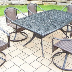 Oakland Living - 7-Pc Rectangular Dining Set - Includes boat shaped table, six swivel chairs and metal hardware. Lightweight and handcast. Chip and crack resistant. Hardened powder coat. Warranty: One year limited. Made from tubular aluminum, cast aluminum steel, and resin wicker. Black color. Minimal assembly required. Swivel chair: 23.25 in. W x 25.5 in. D x 34 in. H (24 lbs.). Table: 70 in. L x 38 in. W x 29 in. H (75 lbs.). Overall weight: 239 lbs.This dining set will be a beautiful addition to your patio, balcony or outdoor entertainment area. Our swivel sets are perfect for any small space, or to accent a larger space. The Oakland Tuscany Collection combines style and modern designs giving you a rich addition to any outdoor setting. The Oakland Tuscany Collection adds functionality and ease of use. The Oakland Tuscany Collection is perfect for any outdoor patio, back yard or garden.
