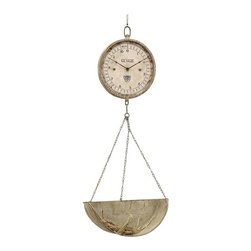 Produce Aisle Clock - We dare you to find a timepiece with as much vintage charm as this one. Inspired by the old-fashioned designs of produce scales at the corner grocery, the numberless face is balanced out by a hanging, gleaming iron basin. What you'll keep inside is your intriguing decision.