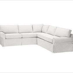 """PB Basic 2-Piece Sectional Slipcover, Denim Warm White - Designed exclusively for our PB Basic Sectional, these easy-care slipcovers have a casual drape, retain their smooth fit, and remove easily for cleaning. Select """"Living Room"""" in our {{link path='http://potterybarn.icovia.com/icovia.aspx' class='popup' width='900' height='700'}}Room Planner{{/link}} to select a configuration that's ideal for your space. This item can also be customized with your choice of over {{link path='pages/popups/fab_leather_popup.html' class='popup' width='720' height='800'}}80 custom fabrics and colors{{/link}}. For details and pricing on custom fabrics, please call us at 1.800.840.3658 or click Live Help. All slipcover fabrics are hand selected for softness, quality and durability. {{link path='pages/popups/sectionalsheet.html' class='popup' width='720' height='800'}}Left-arm or right-arm configuration{{/link}} is determined by the location of the arm on the love seat as you face the piece. This is a special-order item and ships directly from the manufacturer. To view our order and return policy, click on the Shipping Info tab above."""