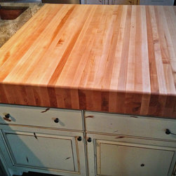 "Butcher block countertops - This top is quite substantial and adds a nice contrast to the countertops. This maple was out of the KODAK factory in Windor, Colorado. The cost on this one is a little higher than the others because of how substantial it is, it is 6"" thick but truly the centerpiece of this kitchen!"