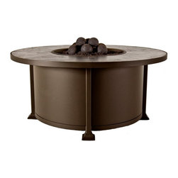 """O W Lee Company Inc - O.W. Lee Casual Fireside Vulsini 54 in. Round Chat Height Fire Pit Table - 51-16 - Shop for Fire Pits and Fireplaces from Hayneedle.com! """"Dear Mom and Dad- Summer camp is great wish you were here. When you come visit please bring the O.W. Lee Casual Fireside Vulsini 54 in. Round Chat Height Fire Pit Table from the backyard. Leave my sister at home."""" Kids probably don't write letters from summer camp anymore when they could just text you but we're pretty sure anyone who leaves home will miss this simple and appealing outdoor accessory. Crafted with a frame of rugged wrought iron and finished in the color of your choice you'll find yourself gathered around this fire pit all year long. Thanks to the simple burner system that employs a standard propane tank lighting is easy and there's very little sooty residue to clean up. You can choose the tile top and fire media that fits your style so all that's left is making sure that you have a seat around this chic fire pit. Runs on propane and/or natural gas conversion kit for natural gas is included. Materials and construction:Only the highest quality materials are used in the production of O.W. Lee Company's furniture. Carbon steel galvanized steel and 6061 alloy aluminum is meticulously chosen for superior strength as well as rust and corrosion resistance. All materials are individually measured and precision cut to ensure a smooth and accurate fit. Steel and aluminum pieces are bent into perfect shapes then hand-forged with a hammer and anvil a process unchanged since blacksmiths in the middle ages. For the optimum strength of each piece a full-circumference weld is applied wherever metal components intersect. This type of weld works to eliminate the possibility of moisture making its way into tube interiors or in a crevasse. The full-circumference weld guards against rust and corrosion. Finally all welds are ground and sanded to create a seamless transition from one component to another. Each frame i"""