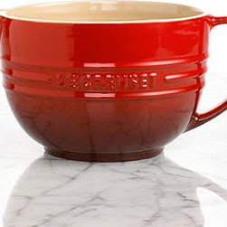 Le Creuset Enameled Stoneware Batter Bowl - Make the chef's job a little easier by giving them Le Creuset's mix-and-pour bowl. It's perfect for anything from pancakes to waffles to crepés. I like that it's dishwasher-safe too.