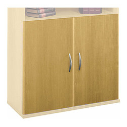 Bush Business - Half Height Shelf Door Kit in Light Oak - Ser - The Light Oak Series C Half Height Shelf Door Kit mounts on our Open Double Bookcase to provide attractive concealed storage.  This stylish contemporary door kit glows with a warm Light Oak finish accented with ergonomically designed polished metal pulls. * Set mounts on Open Double Bookcase. Mounts one each on Open Single Bookcase. Mounts in lower position. Includes two non-handed doors. European-style, self-closing, adjustable hinges. Mocha Cherry Finish. 35 in. W x 0.748 in. D x 28.976 in. H